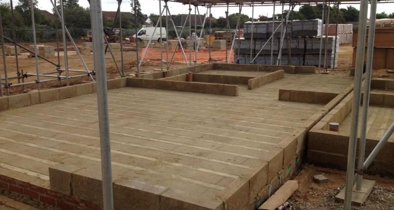 Milbank beam and block floor spans thefloors co for Concrete block floor