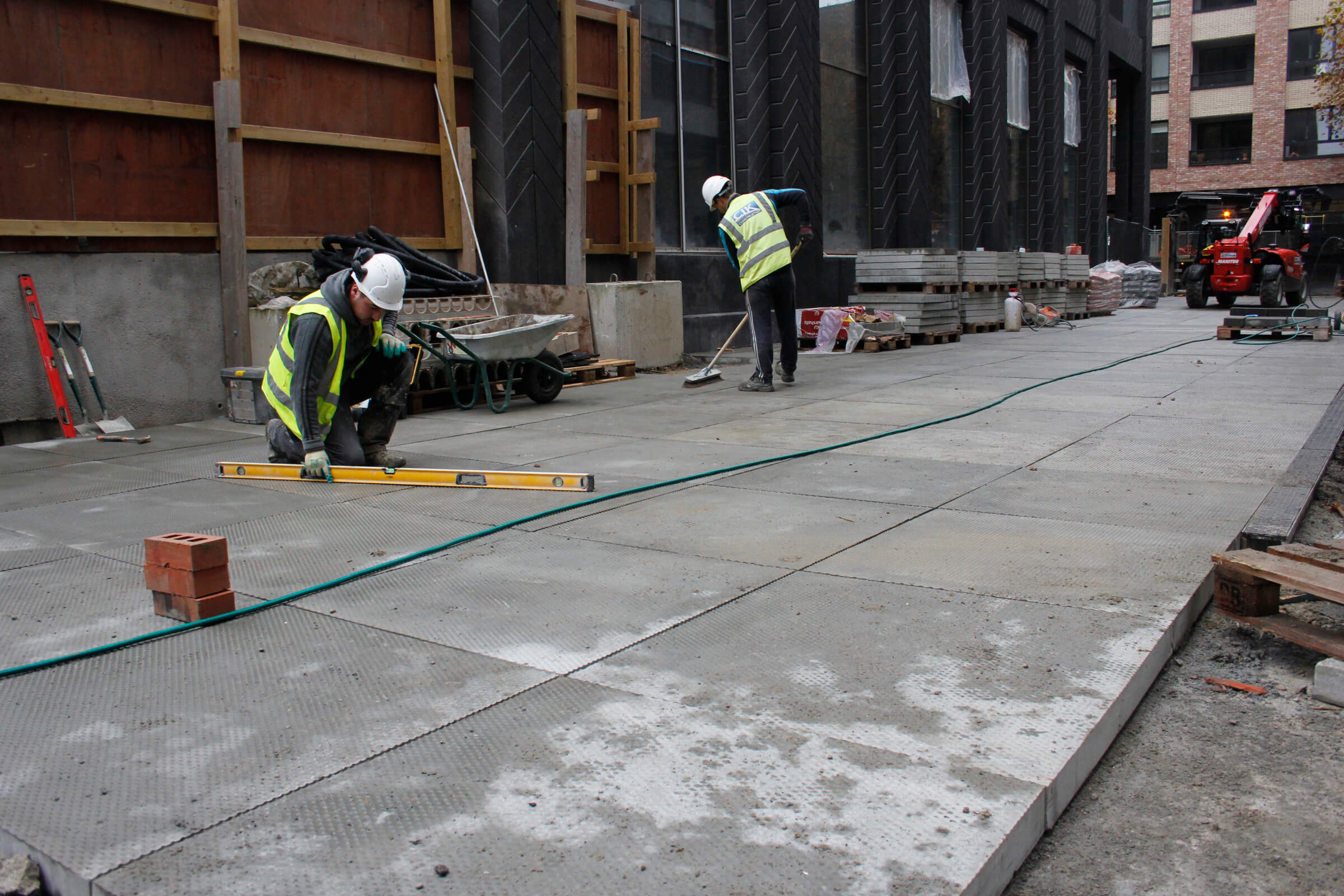 Laying concrete pavement slabs at Fish Island development