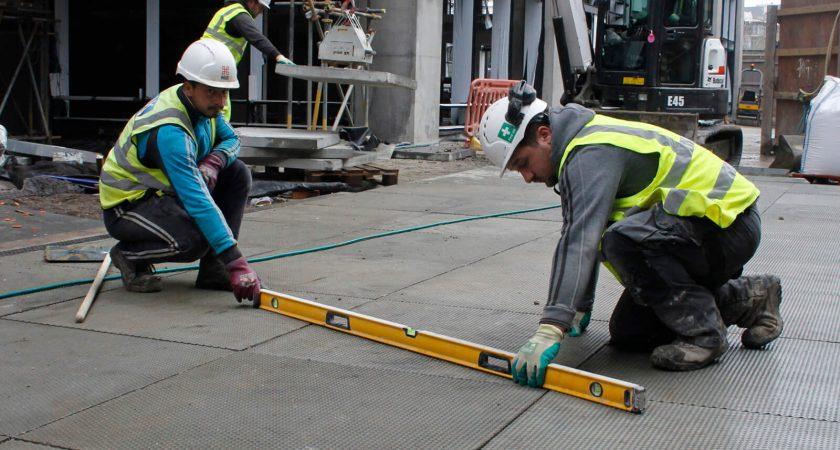 Laying concrete pavement slabs at Fish Island development